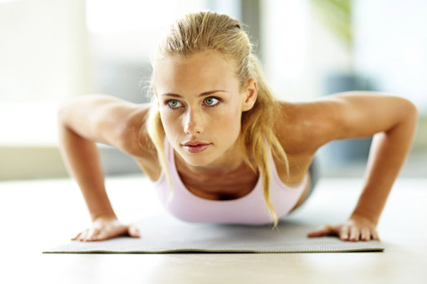 woman-doing-push-ups-pink